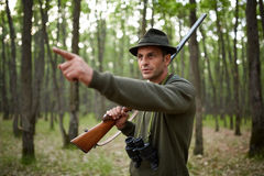 Hunter with shotgun in the forest Royalty Free Stock Photography