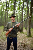 Hunter with shotgun in the forest Royalty Free Stock Photos
