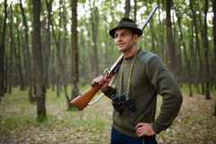 Hunter with shotgun in the forest Royalty Free Stock Image