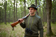Hunter with shotgun in the forest Royalty Free Stock Images