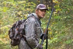 Hunter with shotgun. Portrait of hunter with shotgun during the autumn hunting Stock Photography