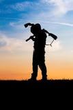 Hunter with shotgun in sunset Stock Photography