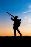 Hunter with shotgun in sunset Stock Image