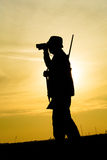 Hunter With Shotgun in Sunset Stock Image