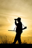 Hunter With Shotgun in Sunset. Hunter With Shotgun on the field in Sunset Royalty Free Stock Image
