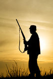Hunter With Shotgun in Sunset Stock Photo