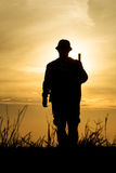 Hunter With Shotgun in Sunset Stock Photos