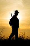 Hunter With Shotgun in Sunset Royalty Free Stock Photo