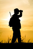 Hunter With Shotgun in Sunset Stock Images