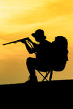 Hunter With Shotgun in Sunset Royalty Free Stock Images