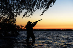 Hunter silhouette at sunset Stock Image