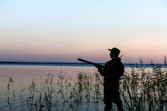 Hunter silhouette at sunset Stock Photography