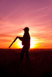Hunter Silhouetted at Sunset Stock Photos