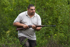 Hunter sneaking with rifle in hands Stock Images