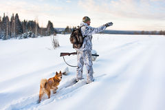 Hunter on the snowy road Royalty Free Stock Photo