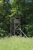 Hunter stand in green summer forest, Germany Stock Photography