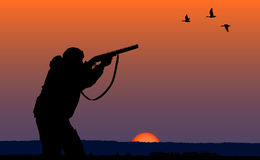 Hunter at sunset background Stock Image