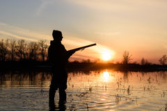 Hunter at sunset. Royalty Free Stock Photography