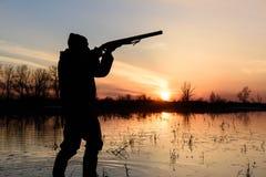 Hunter at sunset. Royalty Free Stock Image