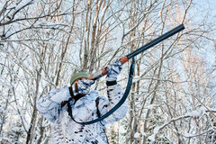 Hunter takes aim from a gun on a clear frosty day Royalty Free Stock Photography