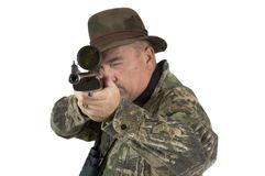 Hunter taking aim. Man in camouflage clothing with rifle taking aim at target on a white background Royalty Free Stock Photography
