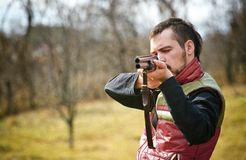 Hunter taking aim Royalty Free Stock Image