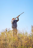 Hunter taking aim at the target. Royalty Free Stock Photography