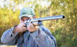 Hunter taking aim at the target. Royalty Free Stock Image