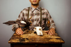 Hunter with taxidermy diorama. Hunter with a taxidermy diorama Stock Photos