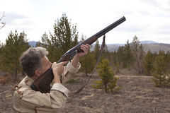 Hunter to hunt with hunting rifle. Hunter in camouflage clothes ready to hunt with hunting rifle Stock Photo