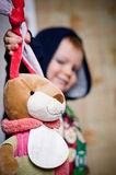 Hunter on toy hares. Little boy holds a toy hare for ears Royalty Free Stock Images
