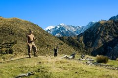 Hunter Using GPS. Hunter in New Zealnd's South Island Mountains using a GPS receiver to locate position Royalty Free Stock Images