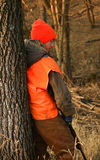 Hunter Waiting. A young hunter is bored while waiting for a deer to shoot Royalty Free Stock Photos