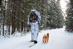 Hunter walking on the skis Stock Image