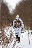 Hunter walking on the snowy glade Royalty Free Stock Photos