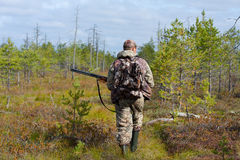 Hunter walking on the swamp Stock Photo