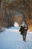 Hunter walking Stock Photo