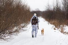 Hunter walking on the winter road Stock Photos