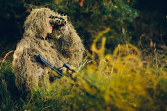 Hunter. Watching through binoculars purpose Royalty Free Stock Images
