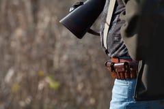 Hunter wears ammunition belt Royalty Free Stock Image