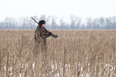Hunter. The hunter on winter hunting hare Stock Image