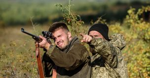 Hunters brutal poachers. Forbidden hunting. Breaking law. Poaching concept. Activity for brutal men. Hunters poachers. Looking for victim. Poachers with rifles stock photography