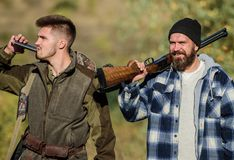 Hunters brutal poachers. Poacher partner in crime. Poaching concept. Activity for brutal men. Hunters poachers looking. For victim. Hunters with rifles in royalty free stock photography