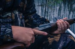 Hunters with guns stock photos