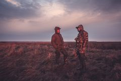 Hunters hunting season in rural field at sunrise royalty free stock images