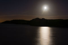 Hunters moon over sea at Sand Point Stock Photo