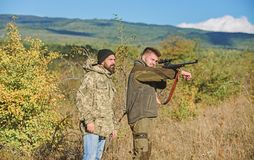 Hunters poachers looking for victim. Poachers with rifles in nature environment. Illegal hunting. Hunters brutal. Poachers. Forbidden hunting. Breaking law stock photo