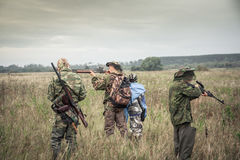 Hunters preparing for hunting in rural field in overcast day during hunting season stock photography