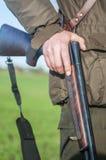 Hunters rifle. Hunter holds a hunting rifle Stock Photo