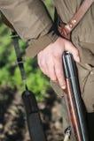 Hunters rifle. Hunter holds hunting rifle Royalty Free Stock Photos